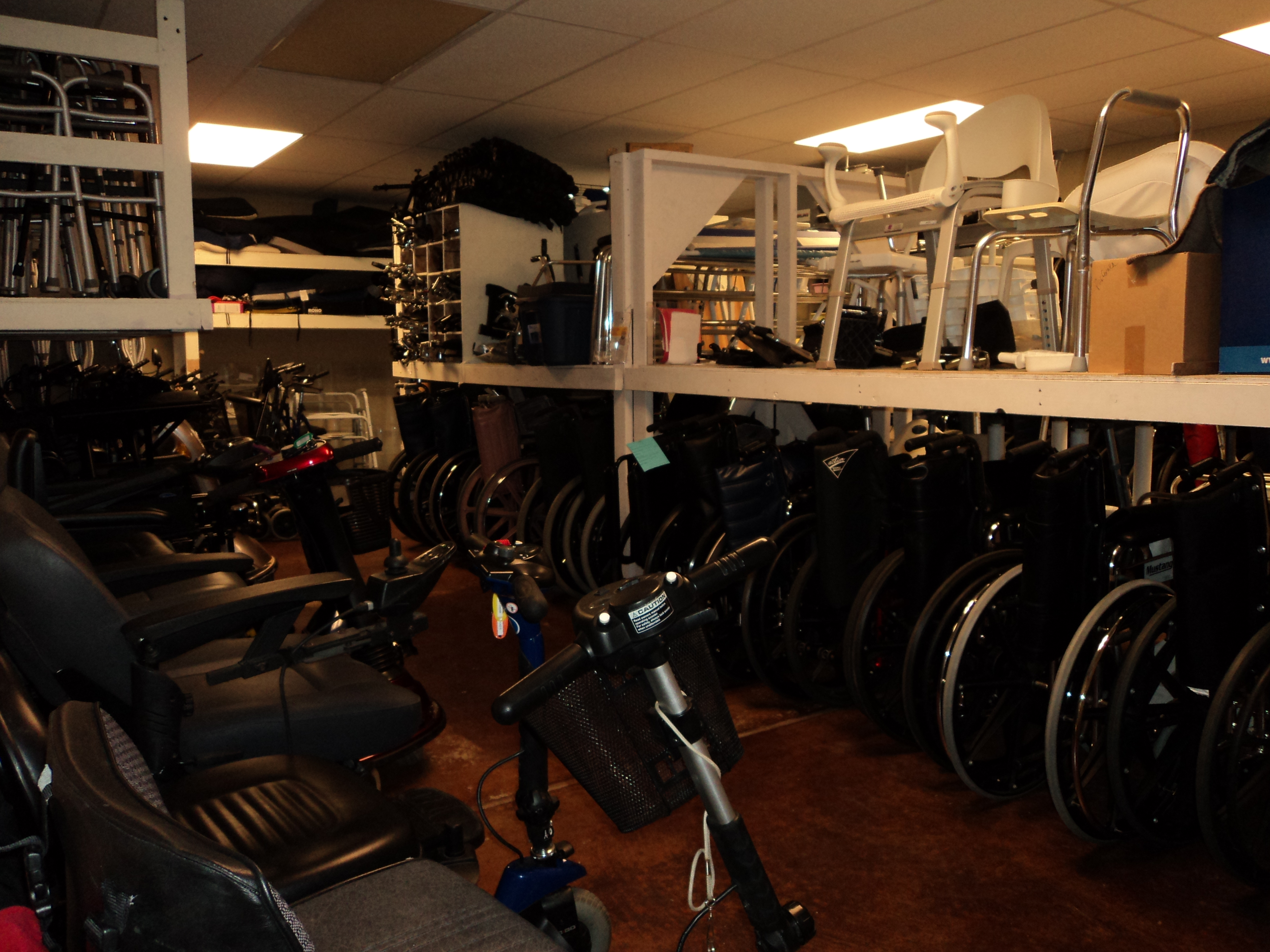 Photo of the Loan closet showing wheelchairs, comodes, scooters, walkers and more that are available for public to rent or buy