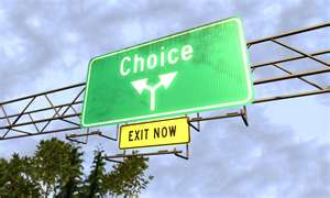 Sign over a road that says Choice, and below are arrows pointing left and right and another sign below the arrows saying exit now
