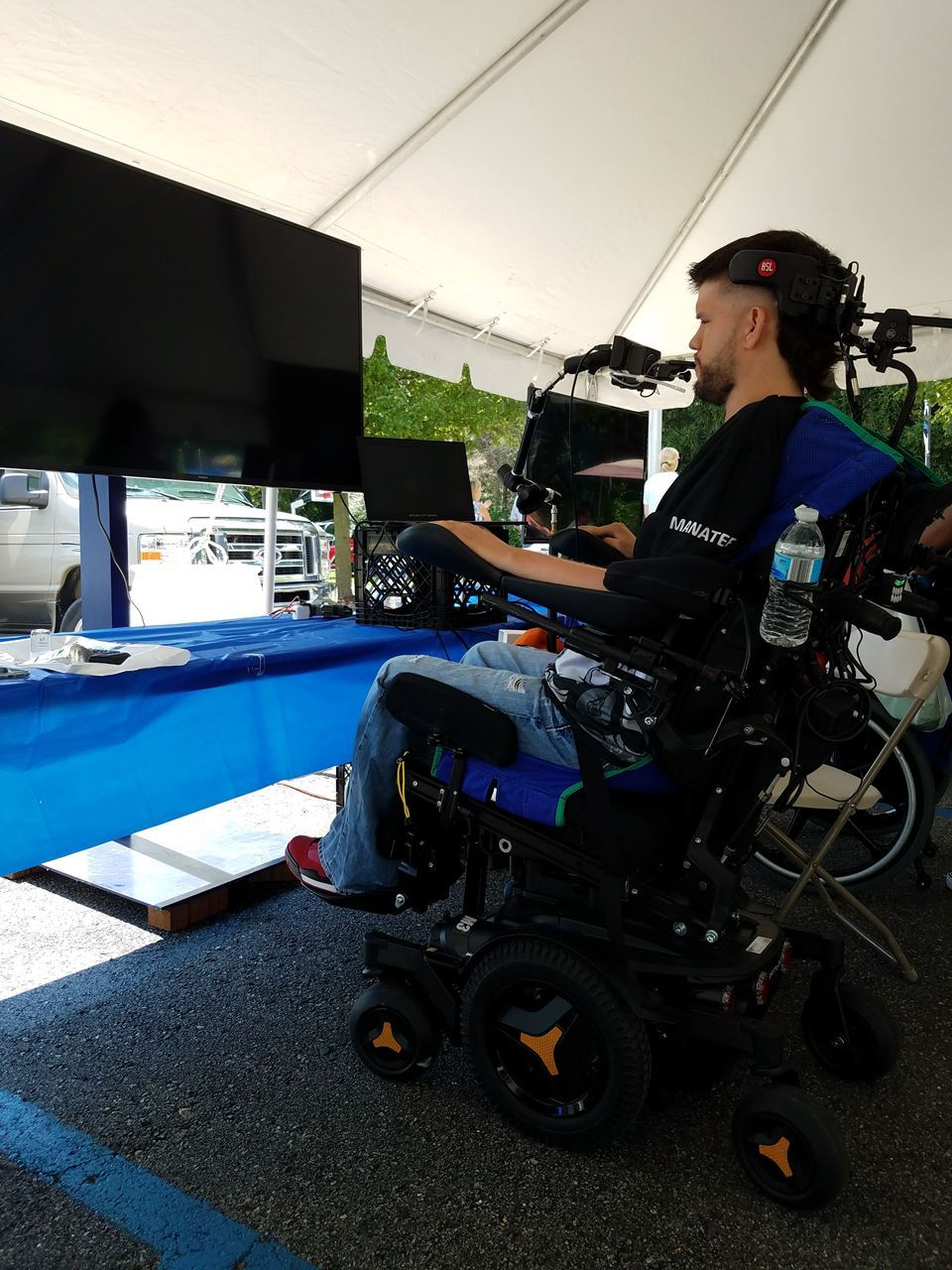 man with high level spinal cord injury using sip and puff technology to play video games